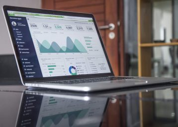 cover image - laptop with statistics