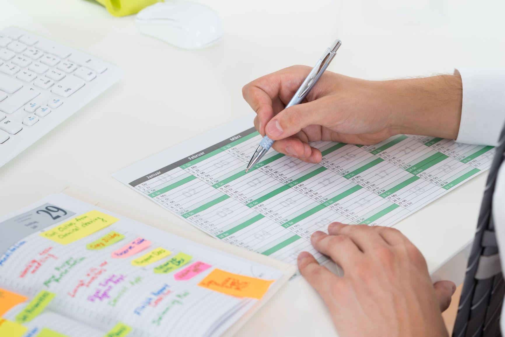 man creating a content calendar